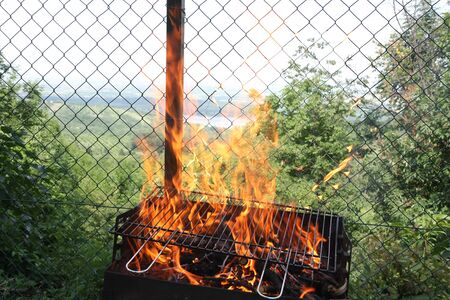 Unwanted flame on grill engulfed the fence Reklamní fotografie