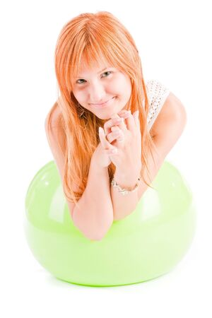 Young smiling girl plays with a ball for fitness photo