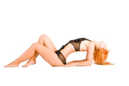 Lying young slim girl in black sexy nightgown Stock Photo