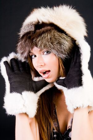 Close-up portrait of the girl in fur-cap and gloves Stock Photo - 3514815