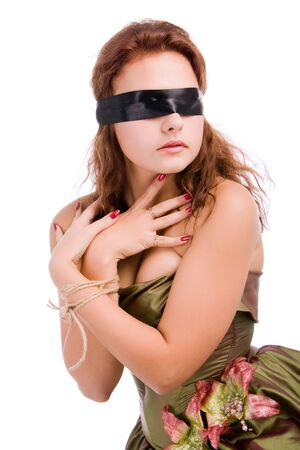 Beautiful girl in a dress, blindfolded and hands tied photo