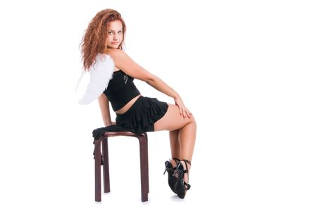 Young pretty sweet girl sits on a chair photo