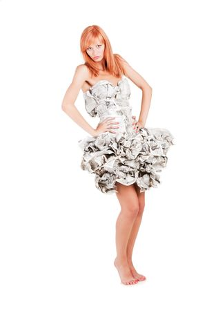 Beautiful young girl standing in a dress made of paper Stock Photo - 5620271