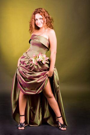 Belle fille dans une robe hem sur�lev� Banque d'images
