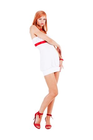 Sneet young girl standing in a white dress with raised hands. white background photo