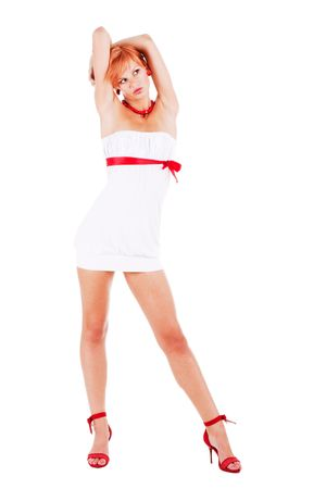 Beautiful young girl standing in a white dress with raised hands. white background photo