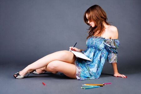Portrait of a sweet young girl write poems in notebook