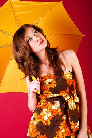 Portrait of a beautiful girl in  dress with a umbrella Stock Photo - 5926759