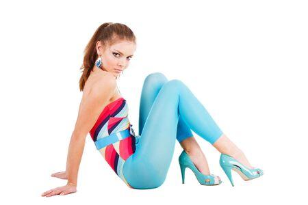 Image d'une jeune fille charmante en bleu sur le plancher Banque d'images