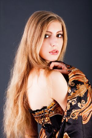 Picture of a beautiful sensuality blond girl in dress Stock Photo