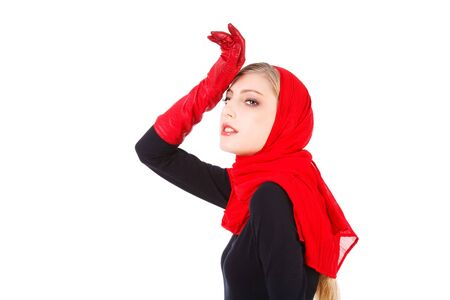 Picture of a beautiful alluring young girl in red gloves Stock Photo