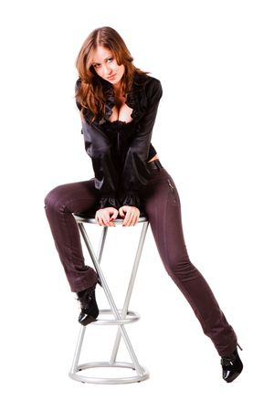 Picture of a young alluring girl in black on chair