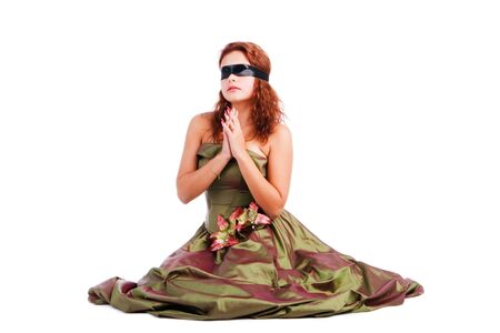 Picture of a beautiful blindfolded girl in dress on floor photo