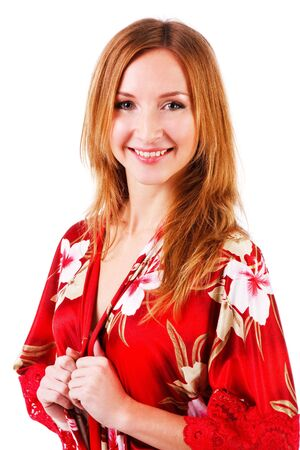 Picture of a young attractive smiling girl in red gown photo