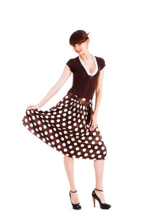 Picture of a young modest beautiful girl in blouse and spotted skirt photo