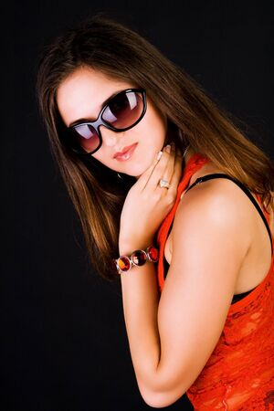 Picture of a beautiful young girl in red blouse and glasses photo