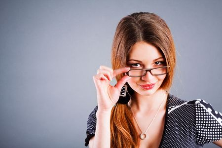 Portrait of a sweet, charming young girl in glasses photo