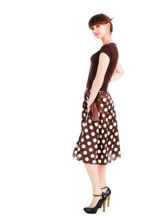 Picture of a young  sensuality  beautiful girl in blouse and spotted skirt. Isolate on white.