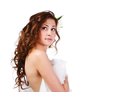 Portrait of a charming girl in white on white background. photo