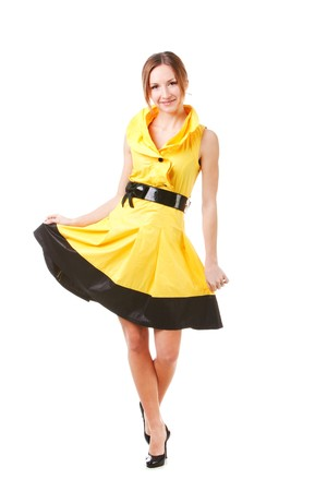Picture of a young pretty girl in yellow dress. Isolated on white.