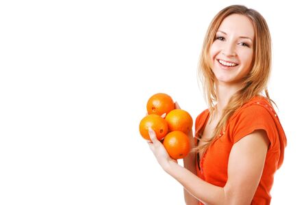 Portrait of a young pretty girl in dress which holds oranges. Isolated on white.