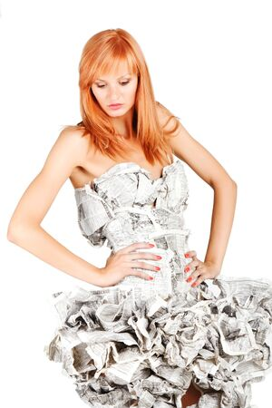 Portrait of a beautiful girl in a newspaper dress