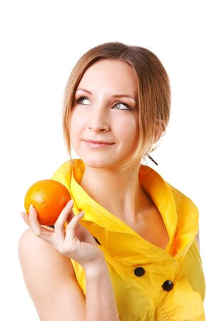 Picture of a young pretty girl in yellow dress which holds oranges. Isolated on white.