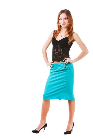 Picture of a charming young lady in blue skirt on white background. photo
