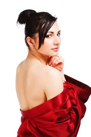 Picture of attractive young naked woman in red gown. Isolated on white.
