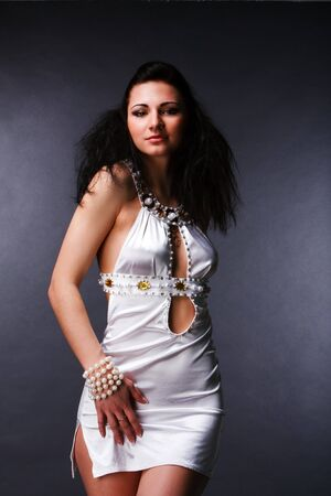 Picture of pretty young woman in white dress photo
