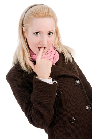 Portrait of a shy blond young girl in coat with finger in mouth photo