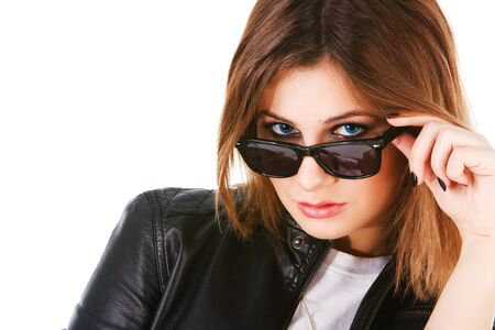 Picture of a charming young girl in sunglasses on white background photo