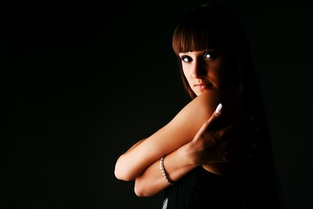 Portrait of a modest alluring young girl in black dress photo