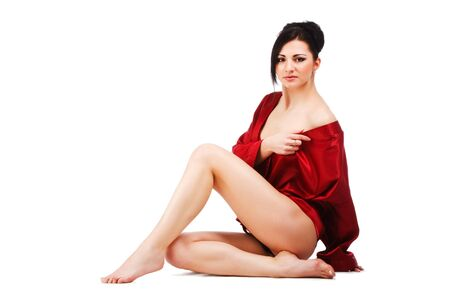 Picture of sensuality young woman in red gown on white background. photo