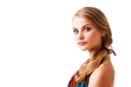 Portrait of a beautiful young lady in colorful dress on white background