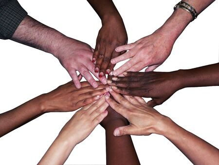 stacked hands of a diverse team of workers to showcase teamwork and unity