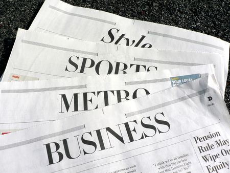 newspaper with its' sections featured