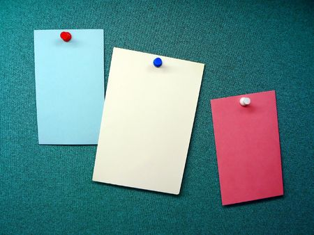 three blank memos posted on the wall of a modular office cubible Stok Fotoğraf