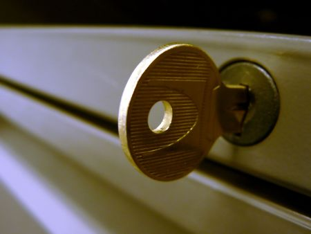 close up photo of modular desk drawers key in its lock