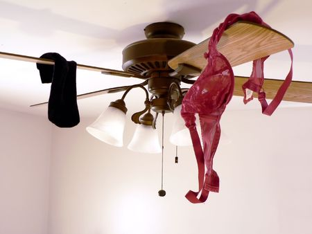 ceiling: conceptual photo of a  interlude showing ceiling with garments hanging from it