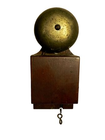 photo of a antique doorbell isolated on a white background