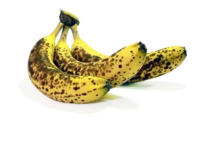 photo of three ripe bananas isolated on a white background Stock Photo