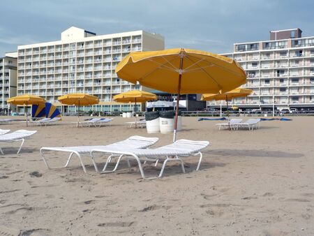 va: beach umbrellas and  lounge chairs at VA Beach before the crowds arrive