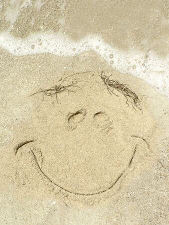 close up of smily face drawing on a  Gulf Coast Florida beach