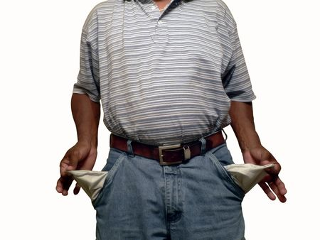 spent: photo of african american man displaying his empty pockets Stock Photo