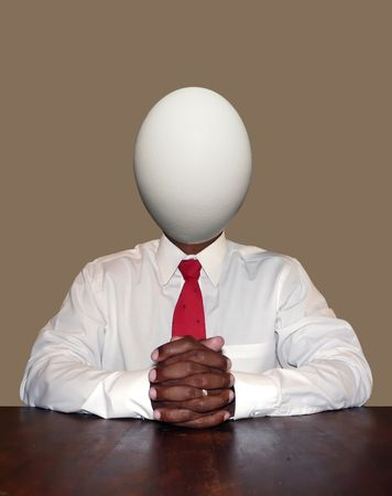 unintelligent: unintelligent and dumb businessman personality concept photo manipulation depicting a egg for a head sitting at a desk ready for a meeting