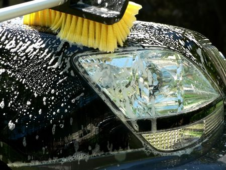suvs hood being washed with a brush Stock Photo