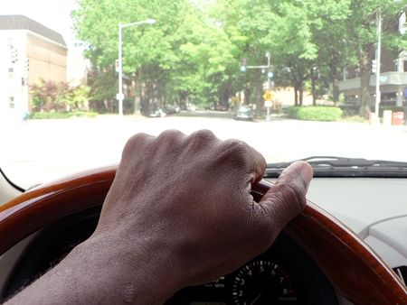 motor vehicle: photo of driving on city road of Washington, DC in motor vehicle interior view