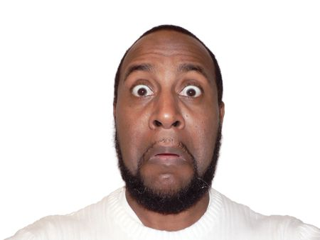 surprised funny face shot of a African American male showcasing facial expression Stock Photo