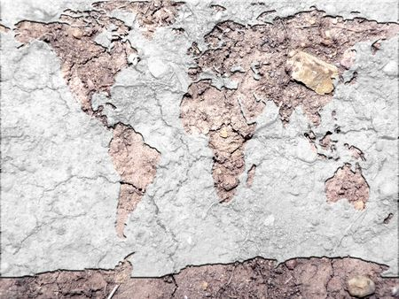 conceptual photo manipulation of a global map and parched earth to depict results of global warming.